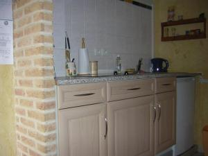 A kitchen or kitchenette at Gite de la liane