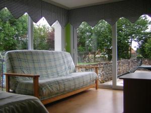 A seating area at Gite de la liane