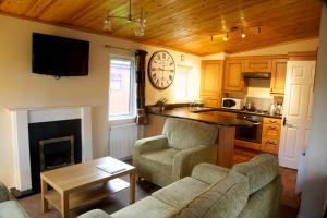 A seating area at Royal Deeside Woodland Lodges