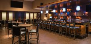The lounge or bar area at The Saratoga Hilton