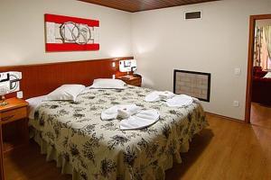 Cama ou camas em um quarto em Áustria Hotel de Monte Verde