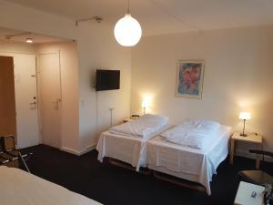 En eller flere senge i et værelse på Hotel Strandparken