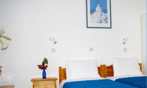 Un ou plusieurs lits dans un hébergement de l'établissement Semprou Rooms