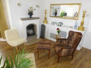 Ein Sitzbereich in der Unterkunft Pension Historisches Wirtshaus an der Lahn