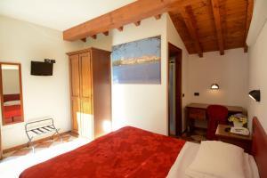 Letto o letti in una camera di A Casa Dei Gonzaga