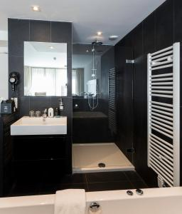 Ein Badezimmer in der Unterkunft Hotel Bommelje