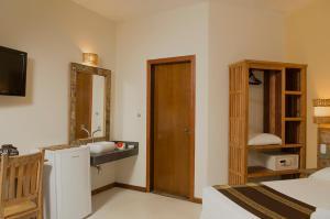Um banheiro em Pousada Tupinamba
