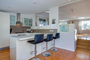 A kitchen or kitchenette at Orcades Beach House