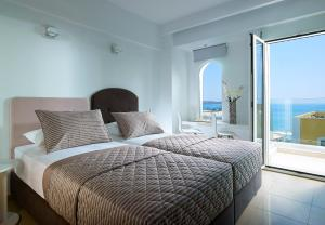 A bed or beds in a room at Coral Hotel