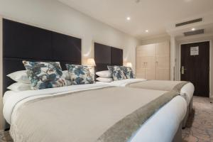 A bed or beds in a room at Blandford Hotel