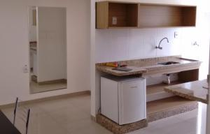 A kitchen or kitchenette at Pantanal Norte Hotel