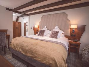 A bed or beds in a room at Ballygally Castle