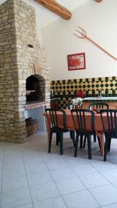 A restaurant or other place to eat at Holiday home Chemin des Grottes