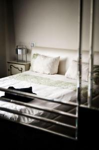 Łóżko lub łóżka w pokoju w obiekcie Villa Romeo