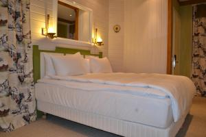 A bed or beds in a room at Piazza Boutique Hotel