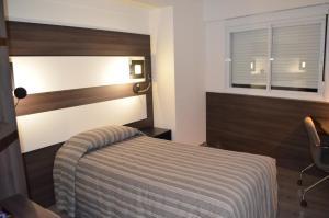 Кровать или кровати в номере Prix Hotel