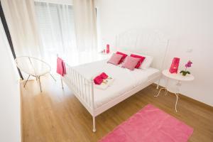 Cama o camas de una habitación en InnOlhão4U
