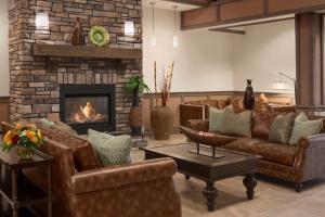 A seating area at Hyatt House Minot- North Dakota