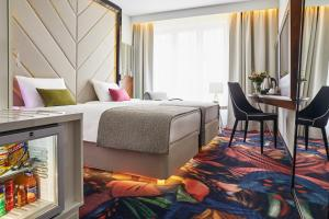A bed or beds in a room at INX Design Hotel
