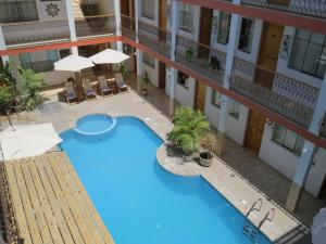 A view of the pool at Hotel Las Flores or nearby
