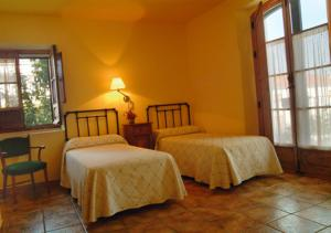 Cama o camas de una habitación en Casa Rural Las Avutardas