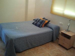 A bed or beds in a room at Hostal Arneva Orihuela