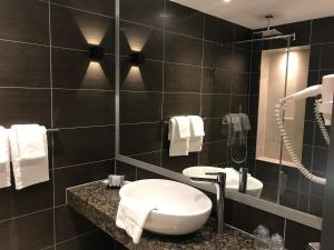 A bathroom at Hotel Levell