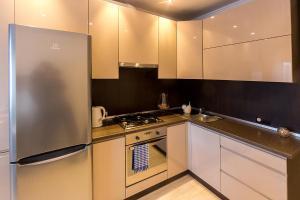 A kitchen or kitchenette at апартаменты от Алекса