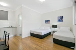A bed or beds in a room at Australian Community Villages