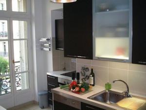 A kitchen or kitchenette at Luxury Rental Marseille Imperial - Rue de la République