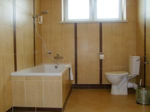 Łazienka w obiekcie Pokoje Gościnne