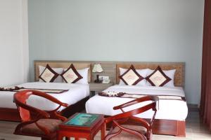 Giường trong phòng chung tại White Sand Cam Ranh Hotel