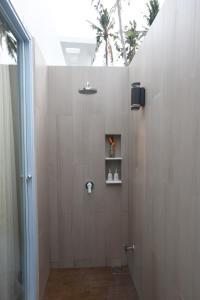 A bathroom at Celes Beachfront Resort Koh Samui - SHA Plus