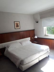 Letto o letti in una camera di Manuelina Taste Hotel