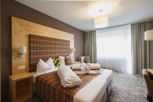 Ein Bett oder Betten in einem Zimmer der Unterkunft Boutique Hotel Erla