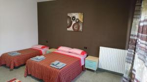 A bed or beds in a room at L'Isola di Romy