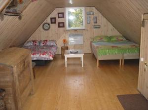 Voodi või voodid majutusasutuse Lonni Nature Eco-Accommodation toas