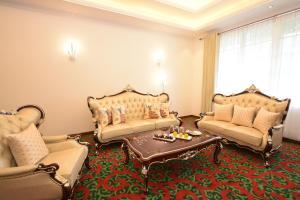 Coin salon dans l'établissement Araliya Green City Hotel