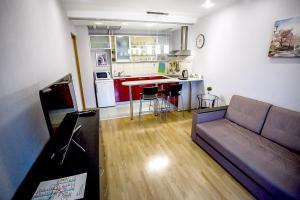 Гостиная зона в Апартаменты Позитив