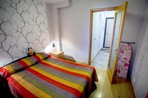 Кровать или кровати в номере Апартаменты Позитив
