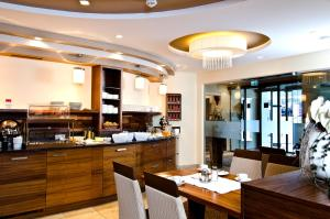 A restaurant or other place to eat at Hotel Garni Astoria