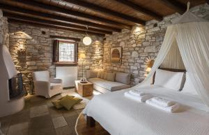 A bed or beds in a room at Adis Oneirou
