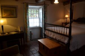 A bed or beds in a room at Quinta do Espírito Santo