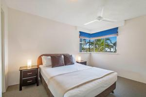 A bed or beds in a room at BreakFree Great Sandy Straits