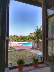 The swimming pool at or near Residence il Colle