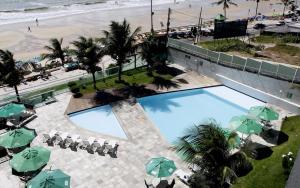 Uma vista da piscina em H Ponta Negra Beach - Luxo ou nos arredores
