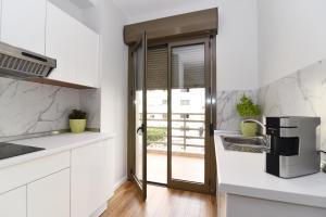 A kitchen or kitchenette at Skanderbeg Square Center Apartments