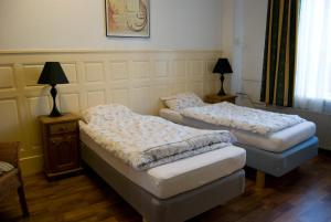 Een bed of bedden in een kamer bij Pension Delfzijl