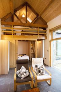 A bunk bed or bunk beds in a room at High View Barn
