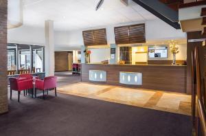 The lobby or reception area at Postillion Hotel Arnhem